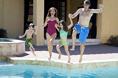 Family Jumping Into Pool